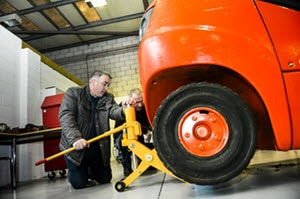 Fork lift trainee in workshop